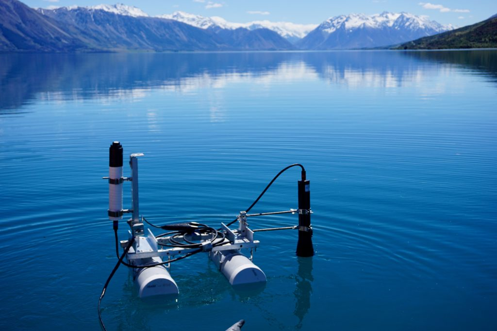 Photograph of recording light measurements on Lake Ohau in Canterbury, New Zealand.